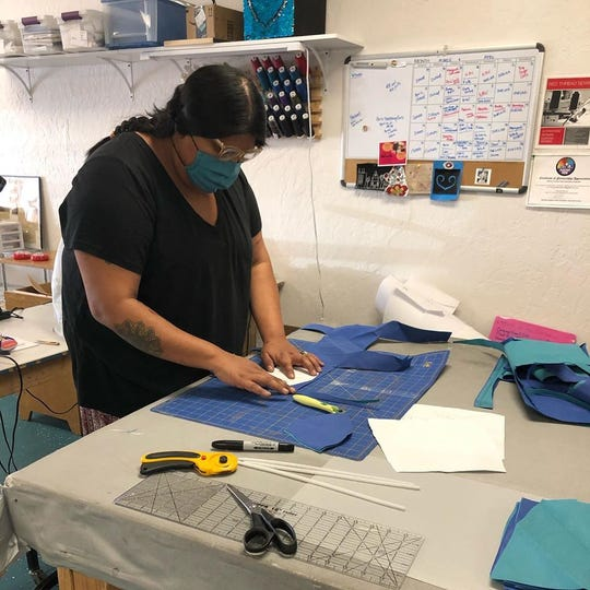 Staff of Threaded Together, a nonprofit organization in Flagstaff, sew homemade face masks to be donated to those providing essential services to the community during the coronavirus pandemic.