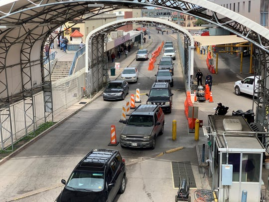 Vehicles travel southbound to Mexico at the DeConcini border crossing in Nogales on March 20, 2020, a few hours before new travel restrictions were to go into effect over the coronavirus.