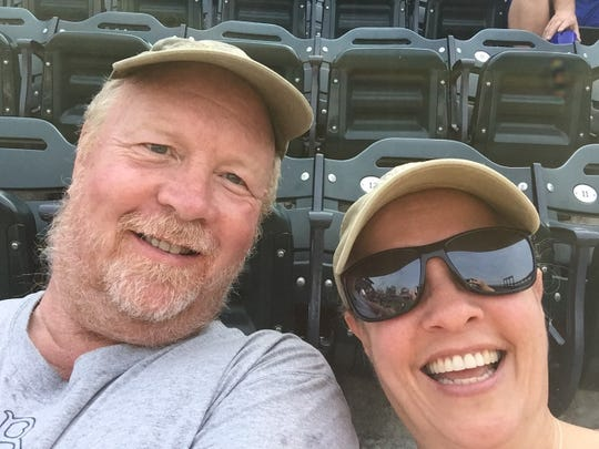 Edward and Carol Lundergan, of New Paltz, pose for a selfie during a baseball game.