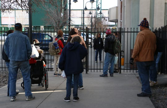 People wait to be let into the homeless shelter on Record Street in Reno on March 20, 2020.