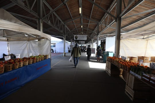 There were gaps between some vendors at the Rochester Public Market on Saturday, March 21, 2020.
