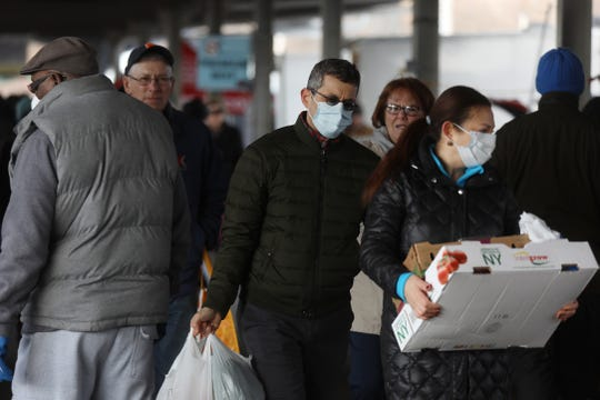 Masks on shoppers at the Rochester Public Market on Saturday, March 21, 2020