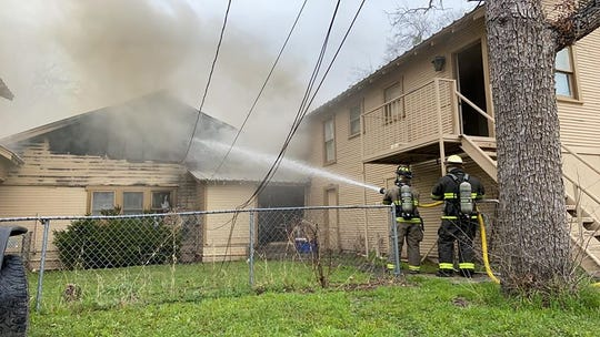 San Angelo firefighters battle a blaze in the 400 block of West Ave. C