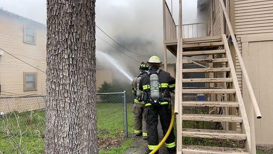 San Angelo firefighters battle a blaze in the 400 block of West Avenue C on March 21, 2020.