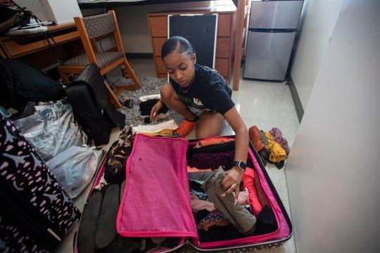 Jaelen Patrick, a freshman at FAMU, 18, packs up her dorm room after being informed the remainder of the semester will be conducted online Friday, March 20, 2020.