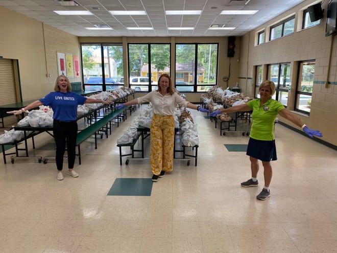 Berneice Cox, Monique Ellsworth and Loranne Ausley delivering food to Riley Elementary. Socially distanced.