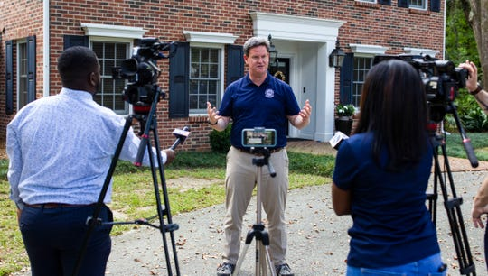 Mayor John Dailey holds a press conference in front of his home regarding coronavirus, Saturday, March 21, 2020.