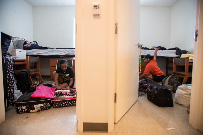 FAMU freshmen twin sisters, Jaelen and Jazlen Patrick, 18, pack up their belongings in their dorm room after being informed the remainder of the spring semester would be conducted online, Friday, March 20, 2020.