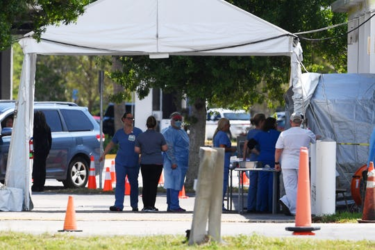 Medical personnel staff a drive-thru coronavirus testing site on March 21 at Cleveland Clinic Indian River Hospital in Vero Beach. All three Treasure Coast Cleveland Clinic hospital properties are hosting drive-thru testing by appointment only.