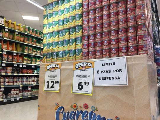 A sign says purchases are limited to six of these items per household Friday, March 20, 2020, in a S-Mart Teresiano branch in Juárez.