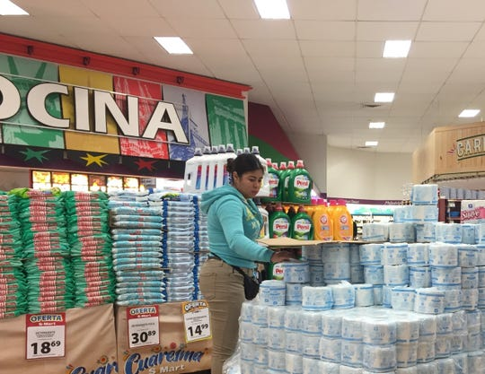 An employee restocks toilet paper Friday, March 20, 2020, at S-Mart Teresiano in Ciudad Juárez.
