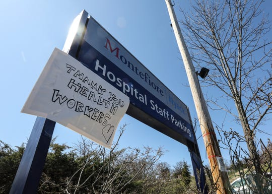 A sign thanking healthcare workers on the staff parking lot at Montefiore-Nyack Hospouat in Nyack on Saturday, March 21, 2020.