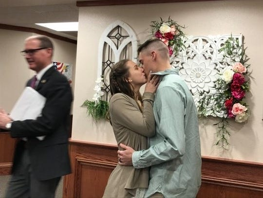 A kiss completes the wedding of Savannah Pollard and William Payne on March 20, 2020, at the Wichita County Courthouse.
