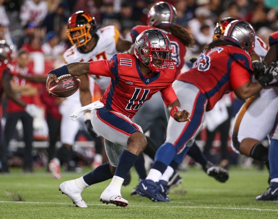 Houston Roughnecks quarterback P.J. Walker runs the ball during a game against the Los Angeles Wildcats.