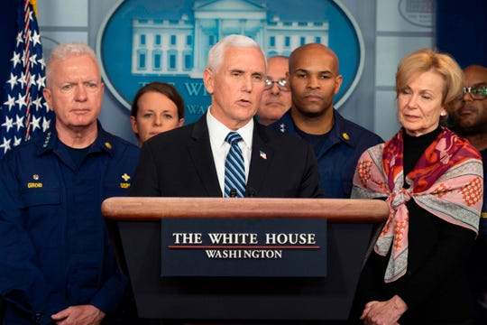 Vice President Mike Pence, center, stands with members of the White House coronavirus task force including Deborah Birx, right, at the White House on March 20, 2020.