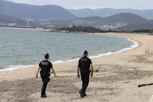 French Gendarmes patrol the beach of Porticcio on the French Mediterranean island of Corsica on March 21, 2020, closed to the public as a strict lockdown comes into in effect in France to stop the spread of COVID-19.