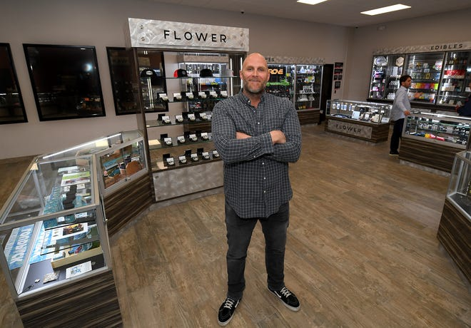 Former NFL player Kyle Turley poses for a portrait inside his cannabis dispensary, Shango, that he recently opened in the Moreno Valley.