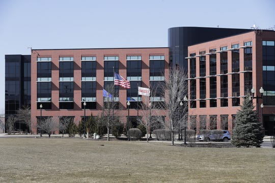 Plexus Corp.'s global headquarters in Neenah emptied out as employees were asked to work from home.