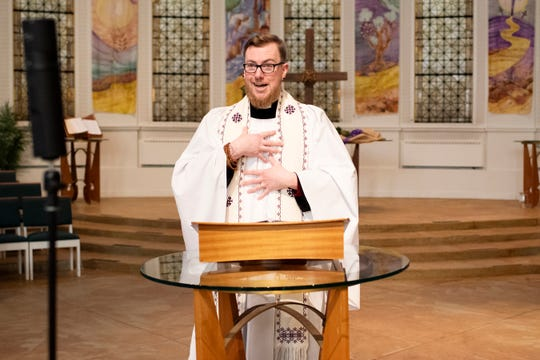The Rev. Nathaniel Craddock streams his second service with Battle Creek's First Congregational Church in an empty sanctuary on Sunday, March 22, 2020. While Gov. Gretchen Whitmer is exempting Michigan churches from penalties of 50+ gatherings, Craddock said the church is following CDC guidelines of social distancing.