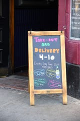A sign at Ruben James on Main Street in Burlington on Sunday March 22, 2020,  has gone take-out and delivery only. Gov. Phil Scott ordered all bars and restaurants to end on-site service to limit the threat of the new coronavirus which causes COVID-19.