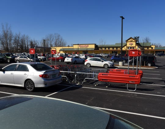 There were plenty of cars in the lot of the Hannaford supermarket on Dorset Street in South Burlington on Sunday, March 22, 2020. The supermarket opened on Saturday.