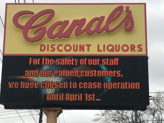 A roadside sign notes Canal's Discount Liquors in Pennsauken has closed temporarily after being deluged with customers during the coronavirus crisis.