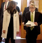Ohio Gov. Mike DeWine and Ohio Department of Health director Dr. Amy Acton prepare to present a news conference on March 20, 2020 on the latest developments in the coronavirus crisis.