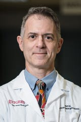 Dr. David Alland, director of Rutgers New Jersey Medical School Public Health Research Institute, and two colleagueshave conducted the first evaluation of an innovative point-of-care test to detect COVID-19.