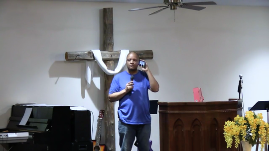 Pastor Stan Braxton of Upper Room Assembly and Worship Center does a live Facebook test of new equipment the church recently received so they can stream services in high definition.