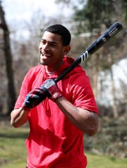 Werner Blakely who plays baseball for Detroit Edison high school is one of the top prospects in the state works out in his backyard Sunday, March 22, 2020. Blakely will probably be drafted but since there's no high school season it makes it hard for scouts to watch him play.
