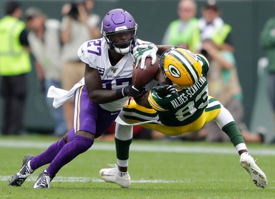 Packers receiver Marquez Valdes-Scantling cannot make the catch against Vikings safety Jayron Kearse during the game Sept. 15, 2019 in Green Bay, Wis.
