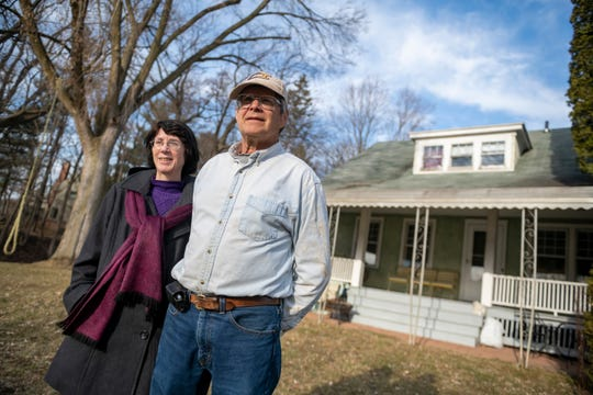 (From left) Jan Esch, an office clerk for Barton Hills Village, and her husband David, the assistant superintendent of the village, stand in front of their home, March 5, 2020.