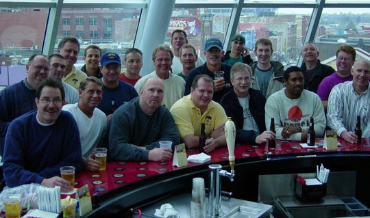 The group poses for a photo between games in 2003.