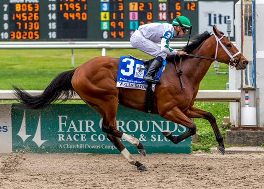 Wells Bayou, ridden by jockey Florent Geroux, wins the 107th running of the $1,000,000 Grade II Louisiana Derby horse race, Saturday at a fanless Fair Grounds racecourse in New Orleans.
