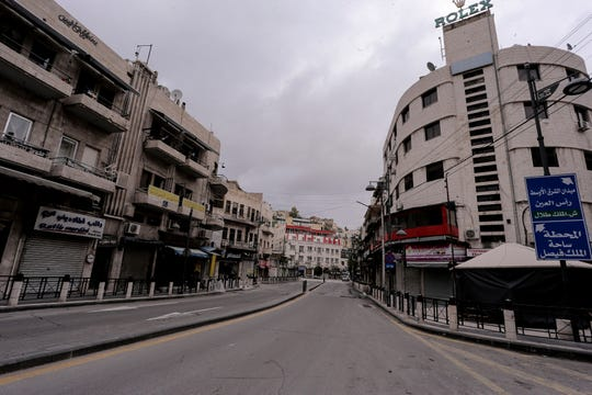 The streets of the Jordanian Capital are seen empty after the start of a nationwide curfew, amid concerns over the coronavirus pandemic, in Amman, Jordan,Saturday, March 21, 2020.