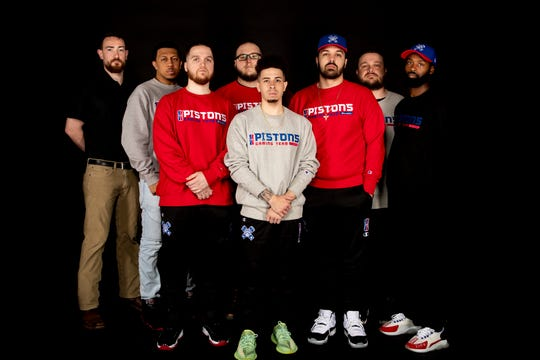 Members of the Pistons GT team are preparing for the NBA 2K League's third season, which has been postponed because of coronavirus concerns. The team features, from left, general manager Adam Rubin, John Fields, Ramo Radoncic, Trenton Simmons, Devin Gossett, Joseph Marrero, Cody Hart and coach Duane Burton.