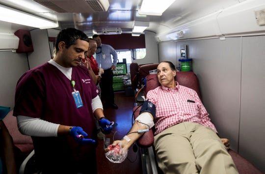 Larry Antonucci, the President and CEO of Lee Health donates blood on Sunday in one of the blood mobiles stationed in front of the American Red Cross off of Cypress Terrace in Fort Myers. NCH President and CEO Paul Hiltz also donated. People donating blood is down because of the coronavirus pandemic and these community leaders are urging those that can to donate.