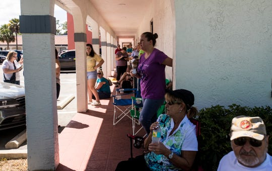 People wait in line to donate blood in one of the blood mobiles stationed at American Red Cross off of Cypress Terrace in Fort Myers. Larry Antonucci, the President and CEO of Lee Health also donated along NCH President and CEO Paul Hiltz. Blood donations are down because of the coronavirus pandemic and these community leaders are urging the community to donate if possible.
