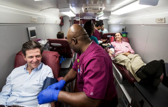 Dave Collins, left, the President of the Board of Directors for Lee Health and Larry Antonucci, the President and CEO of Lee Health donate blood on Sunday in one of the blood mobiles stationed in front of the American Red Cross off of Cypress Terrace in Fort Myers. NCH President and CEO Paul Hiltz also donated. People donating blood is down because of the coronavirus pandemic and these community leaders are urging those that can to donate.