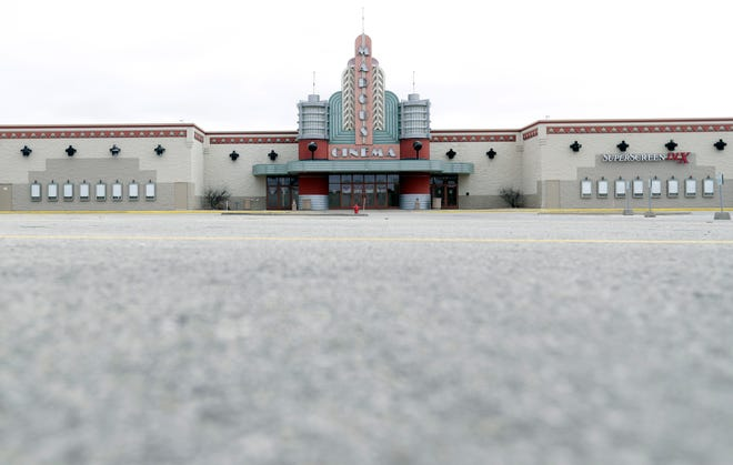The parking lot for Bay Park Cinema sits empty on March 20, 2020, in Ashwaubenon after theaters were forced to close due to the coronavirus pandemic. The theater is reopening Aug. 21.