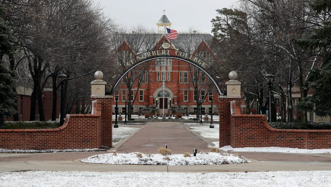 A path through the St. Norbert College campus is void of students and staff on March 20. Students will be allowed back on campus this fall.