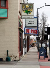 "De Pere Cinema's marquee says ""Keep healthy"" on March 20, 2020, in De Pere, Wis. after theaters were forced to temporarily close due to the coronavirus pandemic. The cinema is offering take-out pizza and popcorn to customers Fridays through Sundays."