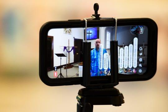 Rev. Matthew Greer livestreams his Sunday service at Piedmont United Methodist Church Sunday, March 22, 2020.