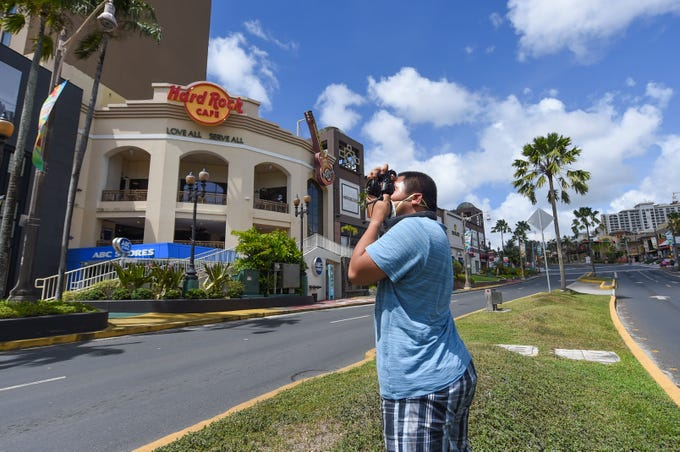 Dededo resident Gian Magana, 23, visits Tumon to photograph its deserted streets and closed businesses during the coronavirus outbreak, March 22, 2020.