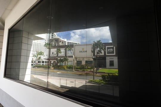 A T Galleria by DFS store window reflects an empty shopping area in Tumon during the COVID-19 pandemic in Tumon, March 22, 2020.