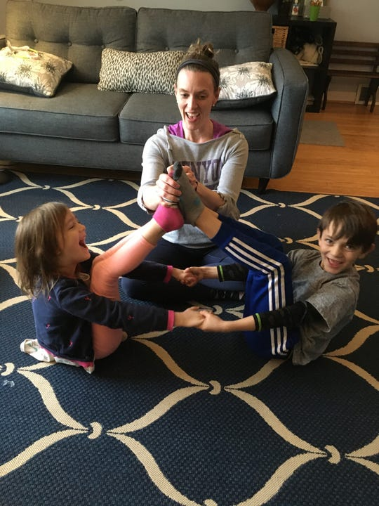Mike Arend's family enjoy group yoga together.