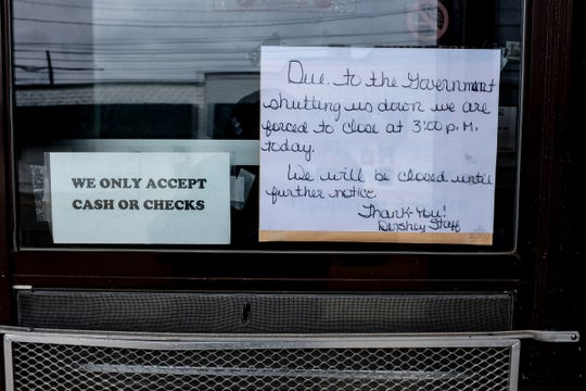 A handmade sign at a restaurant in St. Johns Saturday, March 21, 2020.