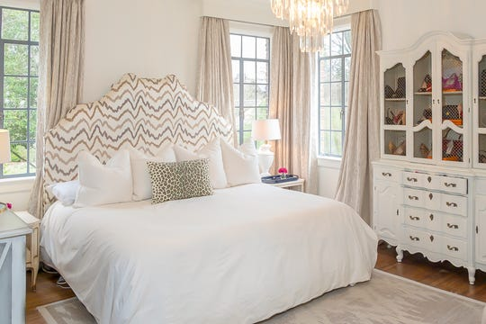 The master bedroom makes good use of the dominant color scheme in the home.