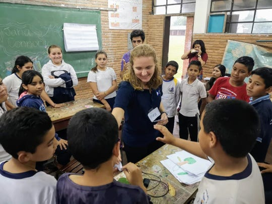 Hannah Dresang, 23, of Shorewood, shown here working with students on an environmental education lesson, had been working with the Peace Corps since September on conservation projects in Paraguay.