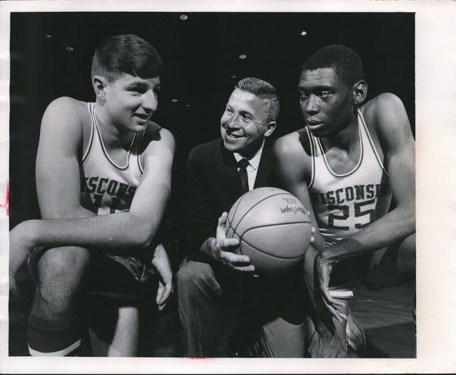 John Erickson (middle), here with Chuck Nagle (left) and Joe Franklin, coached the UW men's basketball team from 1959-67.